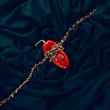 Red pepper on a fashionable shiny black fabric background Stock Photography