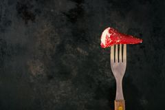 Red pepper filled by cheese impaled on a fork Royalty Free Stock Images