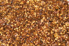 Red pepper flakes background. Shot of red pepper flakes background royalty free stock photo