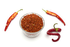 Red pepper flakes and fresh red hot chili peppers Stock Photography
