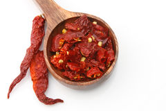 Red pepper flakes withh chilies Royalty Free Stock Photography