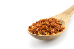 Red pepper flakes in wooden spoon Stock Photo