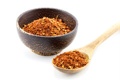 Red pepper flakes in wooden spoon Royalty Free Stock Image