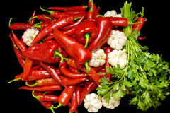 Red pepper, garlic, parsley. Royalty Free Stock Images