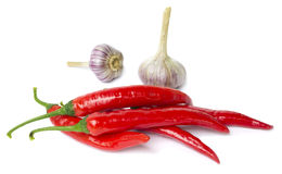 Red pepper and garlic on white Royalty Free Stock Photo