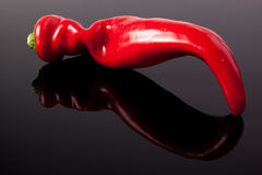 Red pepper. On the glass royalty free stock images