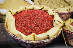 Red pepper in grains Stock Photos