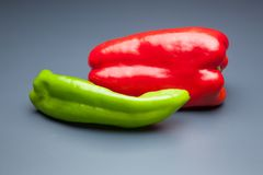 Pepper full of vitamins. Red pepper and green pepper, ingredient for cooking and also for use in salads; It is usually used to make stir-fry, sauces, it is a royalty free stock photography