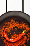 Red pepper with ground paprika. Royalty Free Stock Image