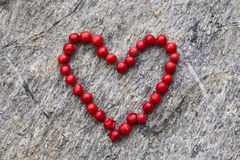 Red pepper heart. On stone Stock Image