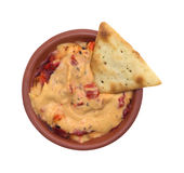 Red pepper hummus in a small bowl with a cracker Stock Photography