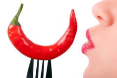 A red pepper is kissed. A red pepper on a fork is kissed Stock Photos