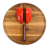 Red pepper on kitchen board with knife Royalty Free Stock Photos