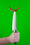 Red pepper on knife Stock Photography