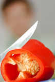 Red pepper and a knife Royalty Free Stock Photo
