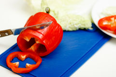 Red pepper and a knife Stock Photo