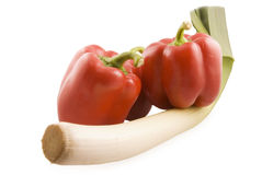 Red pepper and leek. Red sweet peppers and leek on white background Stock Image