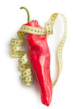 Red pepper and measuring tape Stock Photography