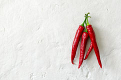 Red pepper on the old whitewashed surface Stock Photo