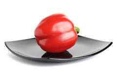 Red Pepper On A Black Plate Stock Photos