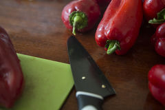 Red pepper paprika. And knife on the table Royalty Free Stock Photos