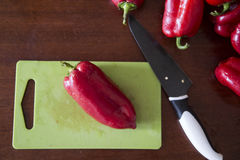 Red pepper paprika. And knife on the table Stock Images