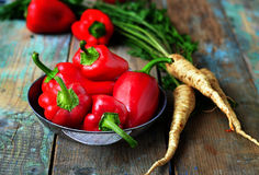 Red pepper and parsley root on a wooden background.selective foc. Us Royalty Free Stock Photo
