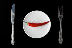 Red pepper on the plate Royalty Free Stock Image