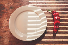 Red pepper and a plate Royalty Free Stock Photos