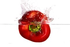 Red pepper plunging in water Royalty Free Stock Photo