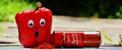 Red Pepper Beside Red Paprika Plastic Bottle Stock Photos