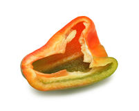 Red pepper sliced in a half, isolated Royalty Free Stock Photos