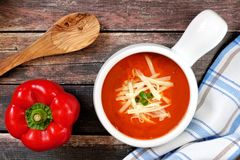 Red pepper soup overhead scene on rustic wood background Stock Image