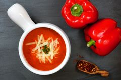 Red pepper soup overhead scene on slate background Stock Photos