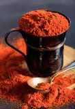 Red pepper spice powder. On a black background Stock Photos