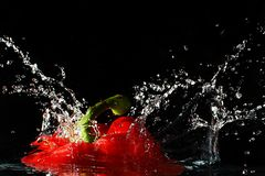 Red pepper splash in water stock photo