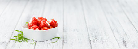Red Pepper & x28;stuffed with cheese& x29; on wooden background & x28;selective. Filled Pimientos on an old wooden table as detailed close-up shot & x28 Stock Image