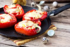 Red pepper stuffed with pasta and cheese on old Stock Image