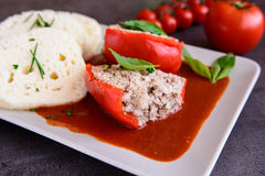 Red pepper stuffed with rice, minced meat and vegetable in tomato sauce with steamed dumpling stock images
