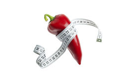 Red pepper and tape measure. Red pepper  and healthy diet Royalty Free Stock Photos