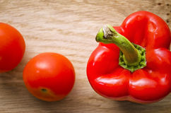 Red Pepper and Tomatoes. Flat lay shot of a red pepper and two tomatoes Stock Photos
