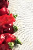Red pepper on white wood surface Royalty Free Stock Photo