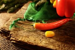 Red pepper on wood stock photography