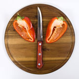 Red pepper on wooden kitchen board Royalty Free Stock Photos