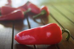 Red pepper. At wooden table, selective focus Royalty Free Stock Photo