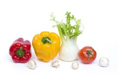 Red pepper with yellow pepper and tomatoes on white background.Vegetables in composition on a white background. stock images