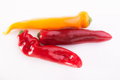 Red pepper. Red and yellow pepper on white royalty free stock images