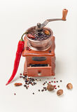 Red pepperand  and  pepper Mill Stock Photography