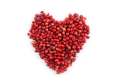 Red peppercorns hart shape Royalty Free Stock Photos