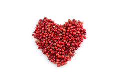 Red peppercorns hart shape Stock Image